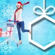 Festive blonde pushing trolley full of gifts — Stock Photo #56890059