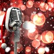 Microphone with Santa hat — Stock Photo #56890637