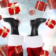 Composite image of santa claus boots — Stock Photo #56891275