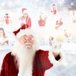 Santa pointing to christmas people collage — Stock Photo #56891969
