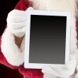 Santa claus showing tablet pc — Stock Photo #56892415