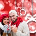 Winter couple holding mugs — Stock Photo #56893199
