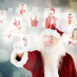 Composite image of santa pointing to christmas people collage — Stock Photo #56893467