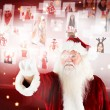 Santa pointing to christmas people collage — Stock Photo #56893877
