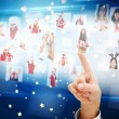 Composite image of hand pointing to christmas people collage — Stock Photo #56894247