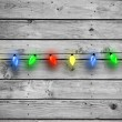 Composite image of christmas lights in a line — Stock Photo #56894385
