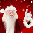 Composite image of santa claus pointing — Stock Photo #56894429