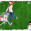 Festive blonde pushing trolley full of gifts — Stock Photo #56894753