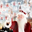 Santa pointing to christmas people collage — Stock Photo #56895507