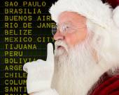 Composite image of santa claus making quiet sign — Stock Photo