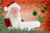 Santa claus checking his list — Stock Photo