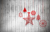 Composite image of hanging red christmas decorations — Stockfoto