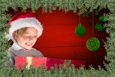 Composite image of festive boy opening gift — Stock Photo