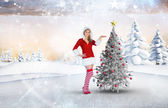 Pretty girl presenting in santa outfit — Stock Photo