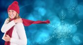 Composite image of happy blonde in winter clothes — Stock Photo