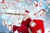 Composite image of santa claus looking through telescope — Stock Photo