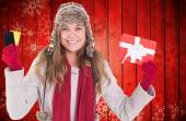 Happy blonde in winter clothes holding gifts — Stock Photo