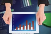Composite image of businesswomans hands holding tablet — Stockfoto