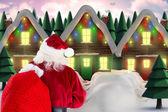 Santa walking in the snow — Stock Photo
