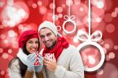 Winter couple holding mugs — Stock Photo