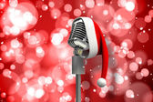 Microphone with Santa hat — Stockfoto