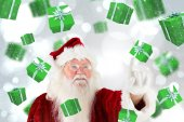 Composite image of santa claus pointing — Stock Photo