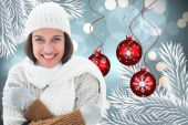 Composite image of brunette in warm clothing — Foto de Stock