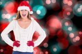 Composite image of festive blonde shouting at camera — Stock Photo