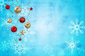 Composite image of hanging christmas decorations and streamers — Stock Photo