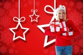 Happy festive blonde with gift — Stock Photo