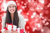 Složený obraz slavnostní bruneta hospodářství dárků — Stock fotografie