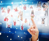 Composite image of hand pointing to christmas people collage — Stock Photo