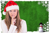 Composite image of festive blonde keeping a secret — Stock Photo