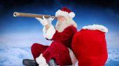 Santa claus looking through telescope — Stock Photo