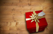 Composite image of christmas present with bow — Stock Photo
