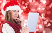 Festive blonde looking at tablet pc — Stock Photo