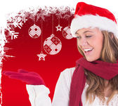 Festive blonde presenting with hand — Stock Photo