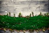 Composite image of fir branch christmas decoration garland — Stock Photo
