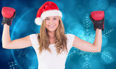 Composite image of festive blonde with boxing gloves — Stock fotografie