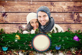 Composite image of young winter couple — Stock Photo
