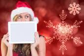 Festive blonde showing a tablet — Stock Photo