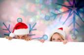 Composite image of happy festive couple — Stock Photo