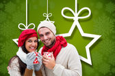 Winter couple holding mugs — Foto de Stock