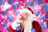 Composite image of santa claus on the phone — Foto de Stock