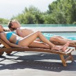 Couple resting on sun loungers — Stock Photo #56904825