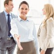 Cheerful businesswoman with colleagues at office — Stock Photo #56905329