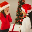 Mother giving her daughter a christmas present — Stock Photo #56906261