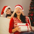 Mother surprising her daughter with christmas gift — Stock Photo #56906883