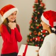 Mother giving her daughter a christmas present — Stock Photo #56906941