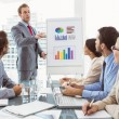 Young business people in board room meeting — Stock Photo #56906947